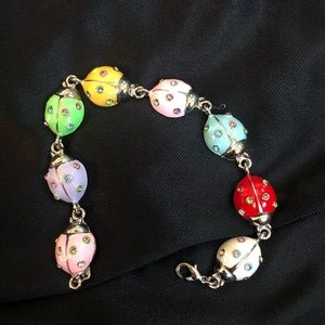 Jewelry - COLORFUL LADYBUG BRACELET NEVER WORN !!